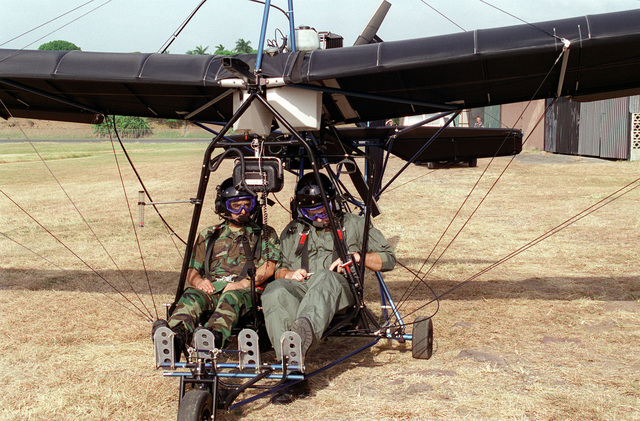 Major General Duran of the Ecuadorian Army goes for a cruise aboard a double seat ultra light aircraft during his visit to USARSO. Exact Date Shot Unknown