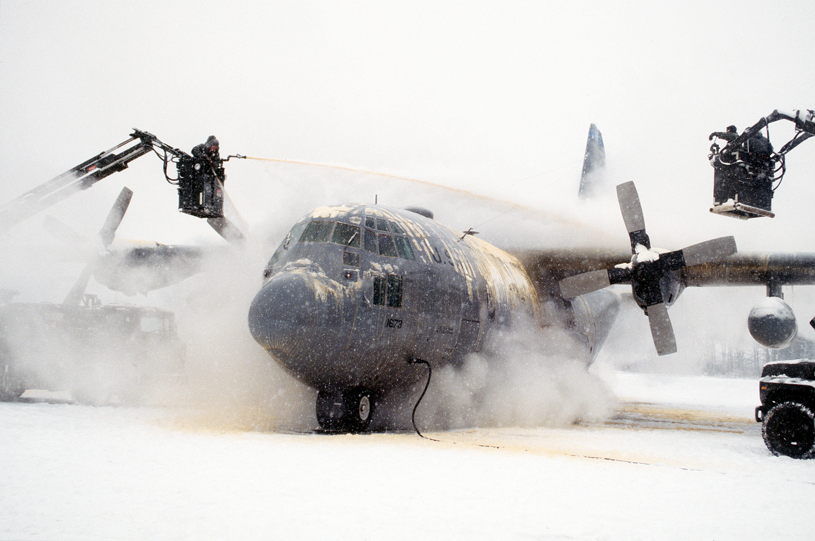 Working under frigid conditions, crew chief and ground support personnel de-ice a 40th Airlift Squadron (AS) C-130H on the snow covered ramp at this United States Air Force Europe (USAFE) base. The 40th AS is assigned to the 7th Wing, Dyess Air Force Base, Texas and is deployed to Ramstein to support Operations Joint Endeavor and Joint Guard from 4 Dec. 1996 to 23 Jan. 1997. Exact Date Shot Unknown