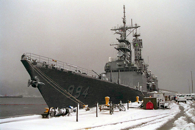 A port quarter bow view of the KIDD CLASS GUIDED MISSILE DESTROYER USS CALAGHAN (DDG 94) docked at the pier during a snowstorm, at Naval Station Everett, WA. The CALAGAHAN arrived from San Diego, CA to undergo repairs on circuits and calibrate electronic gauges