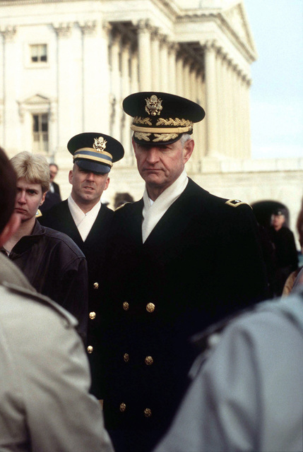 US Army Major General Robert F. Foley, Commander Military District of Washington and Chairman of the Armed Forces Inaugural Committee (center) listens during a debriefing after the completion of the military rehearsal for the Presidential Inaugural. East Front of the US Capital Building, Washington, DC, 12 January 1997