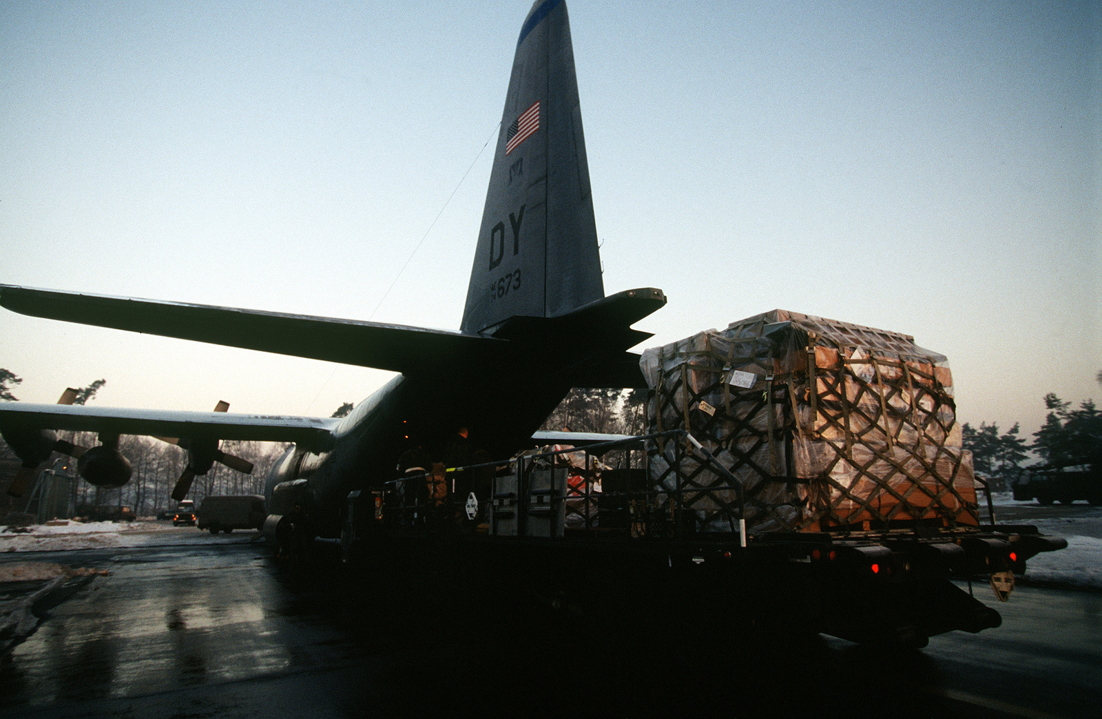 A 40th Airlift Squadron (AS), C-130H is uploaded with cargo by personnel using K-Loaders prior to a mission into Tuzla Air Base, Bosnia at this United States Air Force Europe (USAFE) base. The 40th AS is assigned to the 7th Wing, Dyess Air Force Base, Texas and is deployed to Ramstein for a 45 day Temporary Duty (TDY) tour to support Operation Joint Endeavor