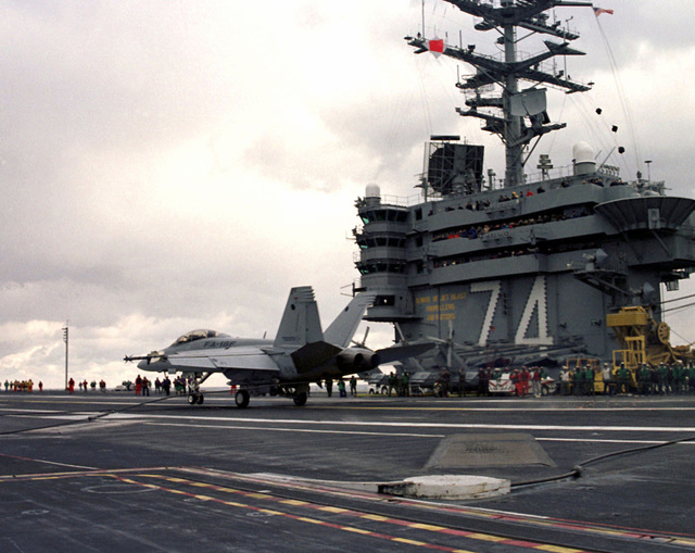 "A US Navy F/A 18F ""Super Hornet"" makes it's first carrier based arrested landing on the deck of the Aircraft carrier USS JOHN C. STENNIS (CVN 74)"