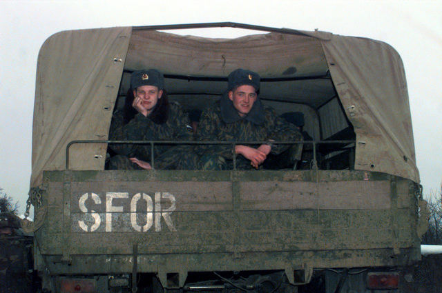 Russian Stabilization Force (SFOR) Soldiers sit in the rear of a 5-ton truck at checkpoint 34A, near the town of Celic, Bosnia-Herzegovina
