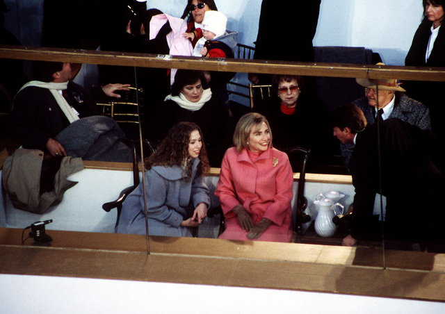 First Lady Hillary Rodham Clinton and daughter Chelsea enjoy the Presidential Inaugural Parade at the Presidential Reviewing Stand