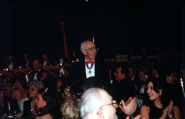 Medal of Honor recipient Franklin Clarke stands and is honored by the applause from attendees of the Medal of Honor Ball