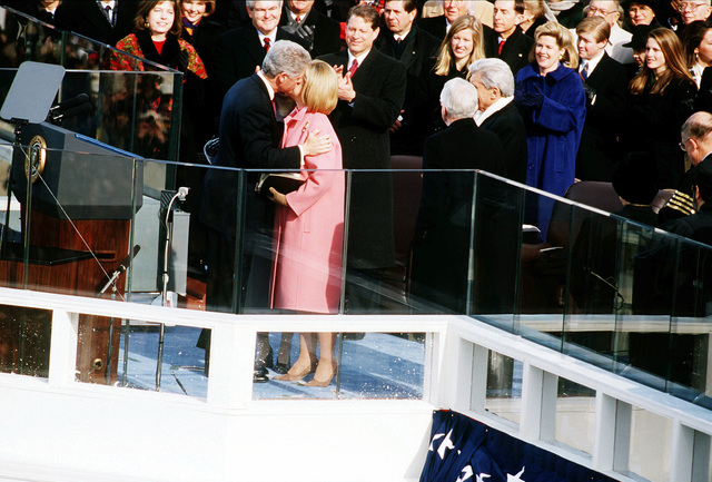 President William Jefferson Clinton and First Lady Hillary kiss at the West Front of the Capitol following the 1997 Presidential Inaugural Swearing-in Ceremony