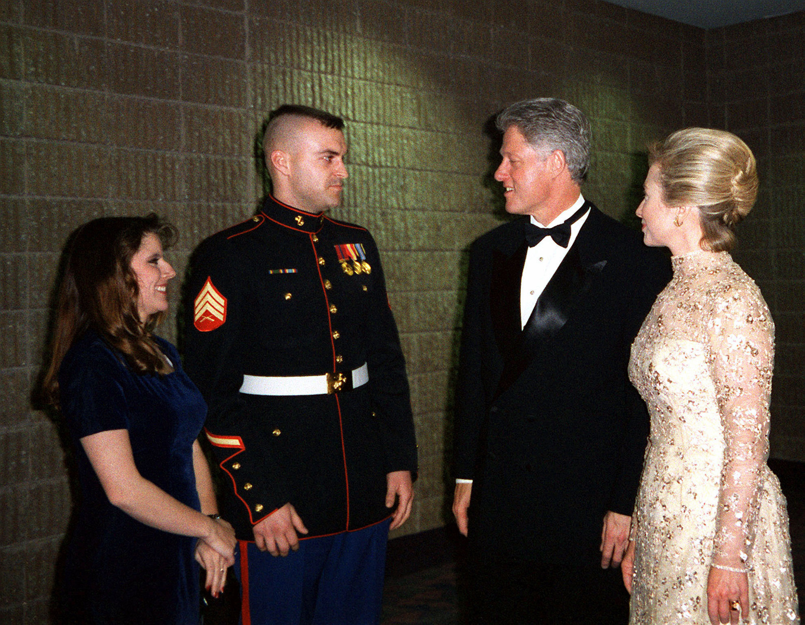President William Jefferson Clinton and First Lady Hillary Rodham Clinton meet US Marine Corps Sergeant Heath Kuhlmann and his wife Monica at the Arkansas Ball. Kuhlmann stood in for the president during the January 12 dress rehearsal of the 1997 Presidential Inaugural Swearing-in Ceremony