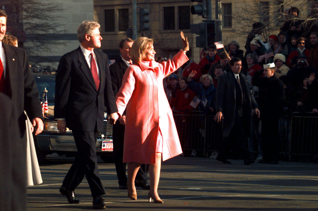 President William Jefferson Clinton and First Lady Hillary Rodham Clinton wave to the crowd during the Presidential Inaugural Parade