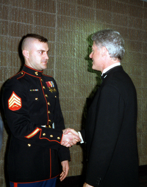 President William Jefferson Clinton shakes hands with US Marine Corps Sergeant Heath Kuhlmann at the Arkansas Ball. Kuhlmann stood in for the president during the January 12 dress rehearsal of the 1997 Presidential Inaugural Swearing-in Ceremony