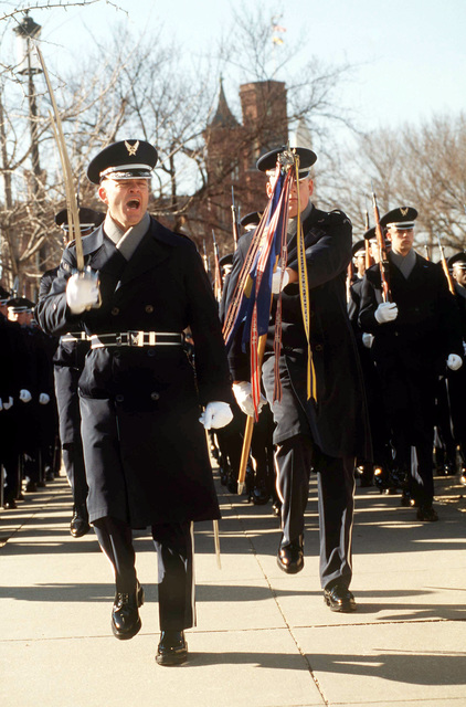 US Air Force Lieutenant Colonel Gary Finchum, Commander of the Air Force Honor Guard, and US Air Force AIRMAN First Class Stephen Tingley, guideon bearer, step out with the rest of their unit in the Presidential Escort during the 1997 Presidential Inaugural parade