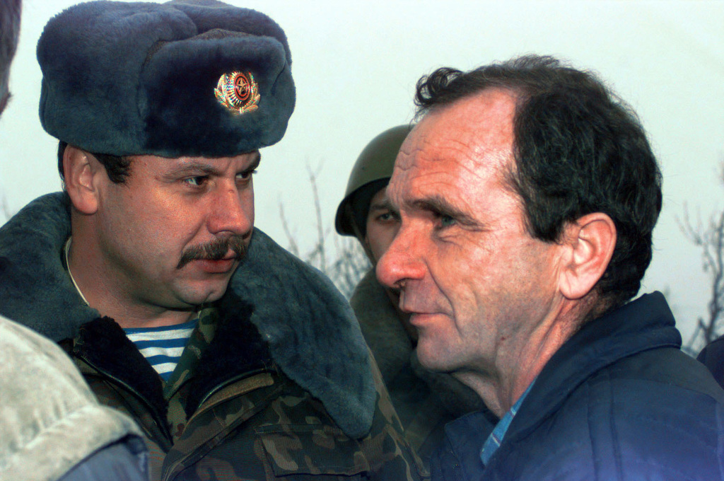A Serbian resident stares at Russian Soldiers at Checkpoint 34A near the town of Gajevi, Bosnia-Herzegovina. The Serbs are protesting the return of Muslim refugees for resettlement into the town
