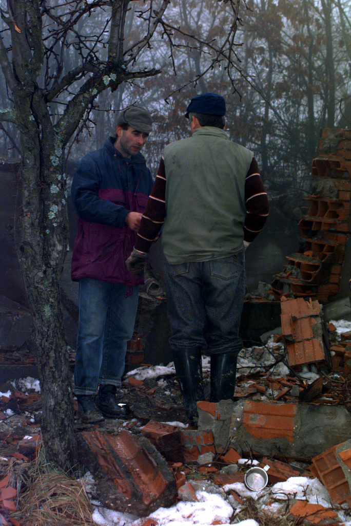 Muslim residents work hard with one another, trying to build the site of their future village in the town of Celic, Bosnia-Herzegovina