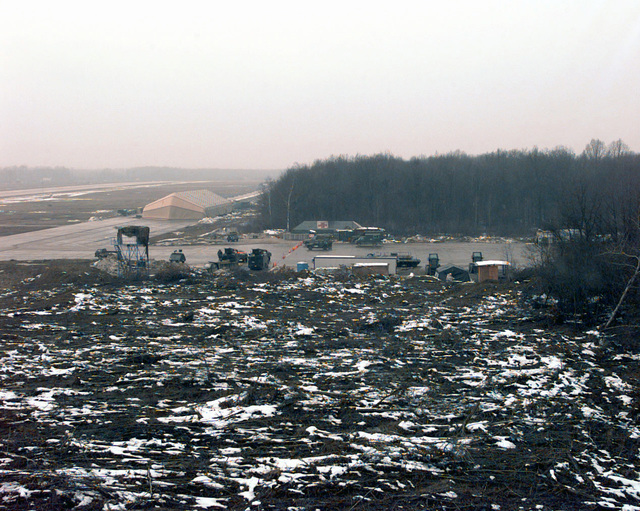 A view of the flightline, taxiway and working area taken from the air traffic control tower of Tuzla Air Force Base. This main staging area for the airlift of supplies and equipment in support of Operation JOINT GUARD is eight kilometers (five les) from one of the task force boundaries. On December 20, 1996, the Implementation Force (IFOR) ssion came to a conclusion and the 1ST Infantry Division was selected to continue serving in Bosnia as part of the new Stabilization Force (SFOR). This decision brought to close the peace ssion of Operation JOINT ENDEAVOR and has been the beginning for the current operation known as Operation JOINT GUARD. JOINT GUARD will continue to monitor the...