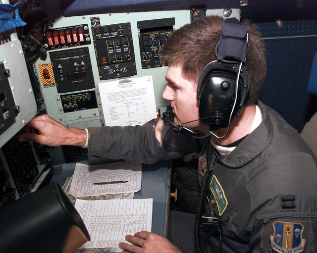Captain Chris Ballard, a navigator assigned to the 61st Airlift Squadron, Little Rock Air Force Base, Arkansas, conducts a status check of the C-130 Hercules transport aircraft's on board navigational equipment enroute to Tuzla Air Base in the former Yugoslavia in support of Operation JOINT GUARD. On December 20, 1996, the Implementation Force (IFOR) mission came to a conclusion and the 1ST Infantry Division was selected to continue serving in Bosnia as part of the new Stabilization Force (SFOR). This decision brought to close the peace mission of Operation JOINT ENDEAVOR and has been the beginning for the current operation known as Operation JOINT GUARD. JOINT GUARD will continue to...