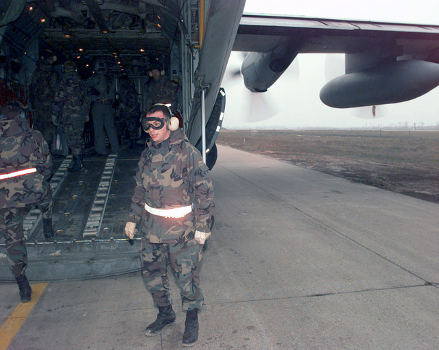 Major Leonard Heavner, the Deputy Commander of the 4100 Group (Provisional), completes another engine-running off load of a C-130 Hercules transport aircraft on a taxiway of Tulza Air Base in support of Operation JOINT GUARD. He and the personnel that support the aircraft meet an arriving aircraft with in five seconds. The complete offload takes well under thirty minutes. On December 20, 1996, the Implementation Force (IFOR) mission came to a conclusion and the 1ST Infantry Division was selected to continue serving in Bosnia as part of the new Stabilization Force (SFOR). This decision brought to close the peace mission of Operation JOINT ENDEAVOR and has been the beginning for the...