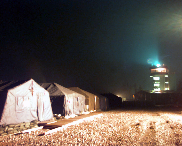 When night falls over Tuzla Air Base, and the cold wind howls against the tents that people here call home, there is a calm here that comes from a group of strangers joining together to complete a mission and becoming a family. On December 20, 1996, the Implementation Force (IFOR) mission came to a conclusion and the 1ST Infantry Division was selected to continue serving in Bosnia as part of the new Stabilization Force (SFOR). This decision brought to close the peace mission of Operation JOINT ENDEAVOR and has been the beginning for the current operation known as Operation JOINT GUARD. JOINT GUARD will continue to monitor the militaries of the former warring factions and provide a...