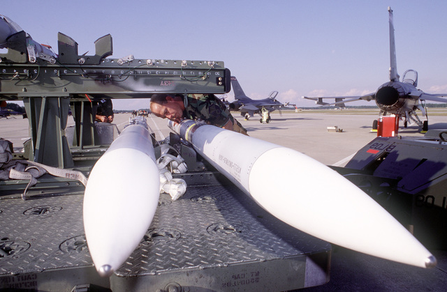 Before WILLIAM TELL '96 static load competition, MASTER SGT. Kevin Nelson, N.D. Air National Guard's 119th Fighter Wing, inspects one of the AIM 120 AMRAAM air-to-air missile, 23 - 25 October 1996. Held biennially at Tyndall Air Force Base, Fla., and conducted by Air Combat Command, William Tell '96 pushes fighter units, including those from Canada, to achieve air superiority under combat conditions, to intercept and destroy enemy jets. And it assesses tactics and weapons and fine-tunes air and ground crews