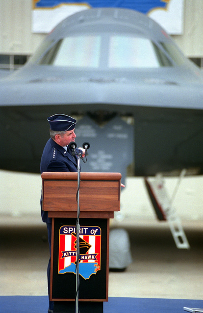 """GEN Ronald R. Fogelman, Air Force CHIEF of STAFF, stands at the podium and introduces the B-2 """"Spirit of Kitty Hawk"""" stealth bomber to attendees at the dedication-naming of the B-2. Exact Date Shot Unknown"""