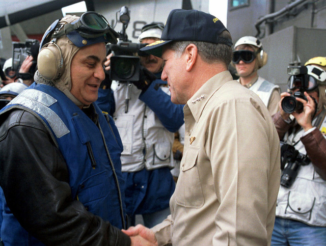 Israeli Minister of Defense Yitzhak Mordechai (left) is greeted on board the nuclear powered aircraft by VADM Charles Abbot, Commander, Sixth Fleet