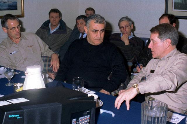VADM Charles Abbot (right), Commander, Sixth Fleet, explains the capabilities of the USS THEODORE ROOSEVELT (CVN-71) Battle Group to Israeli Minister of Defense Yitzhak Mordechai (center) as RMDL Gregory Johnson (left), Commander, Carrier Group 8 looks on