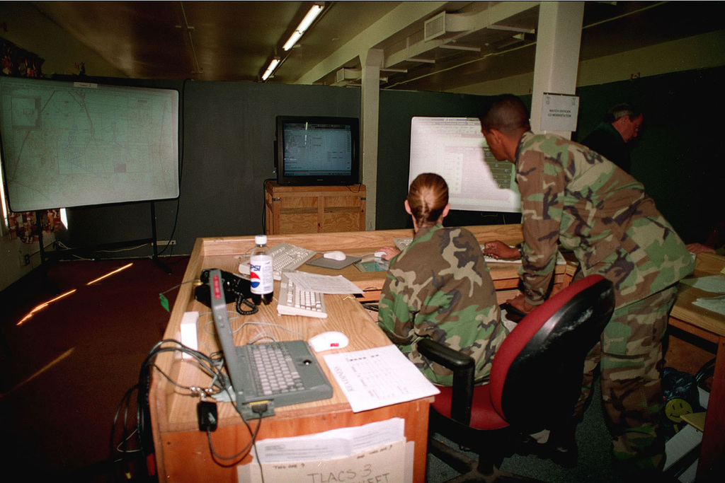 1ST LT. Maury from Combat Service Support Enterprise, works on the new computer Qualcomm/TCO system, that tracks troop movement and is able to communicate directly with the unit in order to recieve or send situational reports