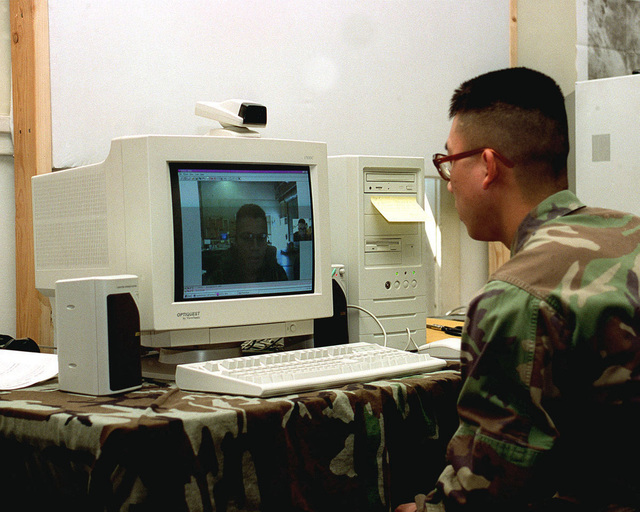 CPL. Wu from Combat Service Support Enterprise, speaks with SGT. Pruitt by use of the new Video Telephone Conferencing System. This system allows two people to speak with each other over the computer with live sound and visual feedback