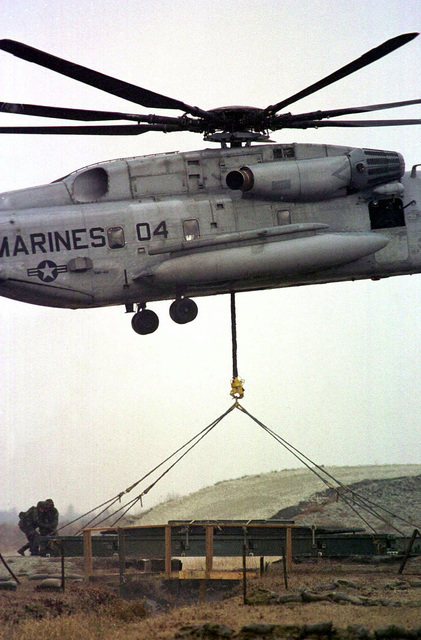 A CH-53E Sea Stallion airlifts a Medium Girder Bridge section to a Helicopter Support Team (HST), during Revised Capabilities exercise
