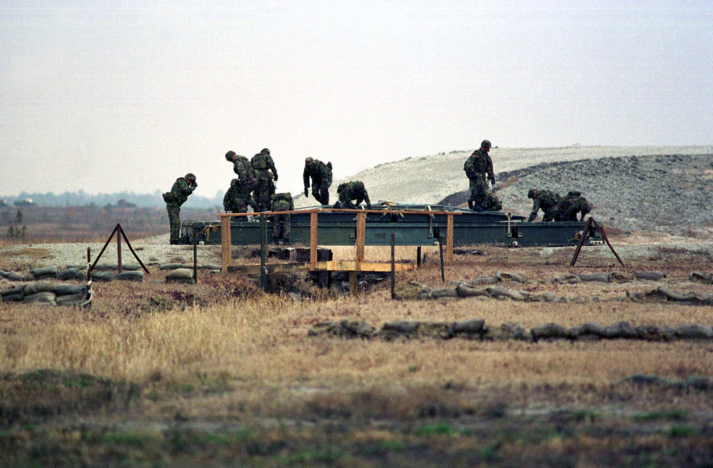 A team from Bridge Company begins to prepare a Medium Girder Bridge that was airlifted into place by a CH-53E Super Stallion helicopter at OP-5 , Camp Lejeune, NC. This team was rehearsing for a demonstration that would be given the following day as part of the REVISED CAPABILITIES Exercise