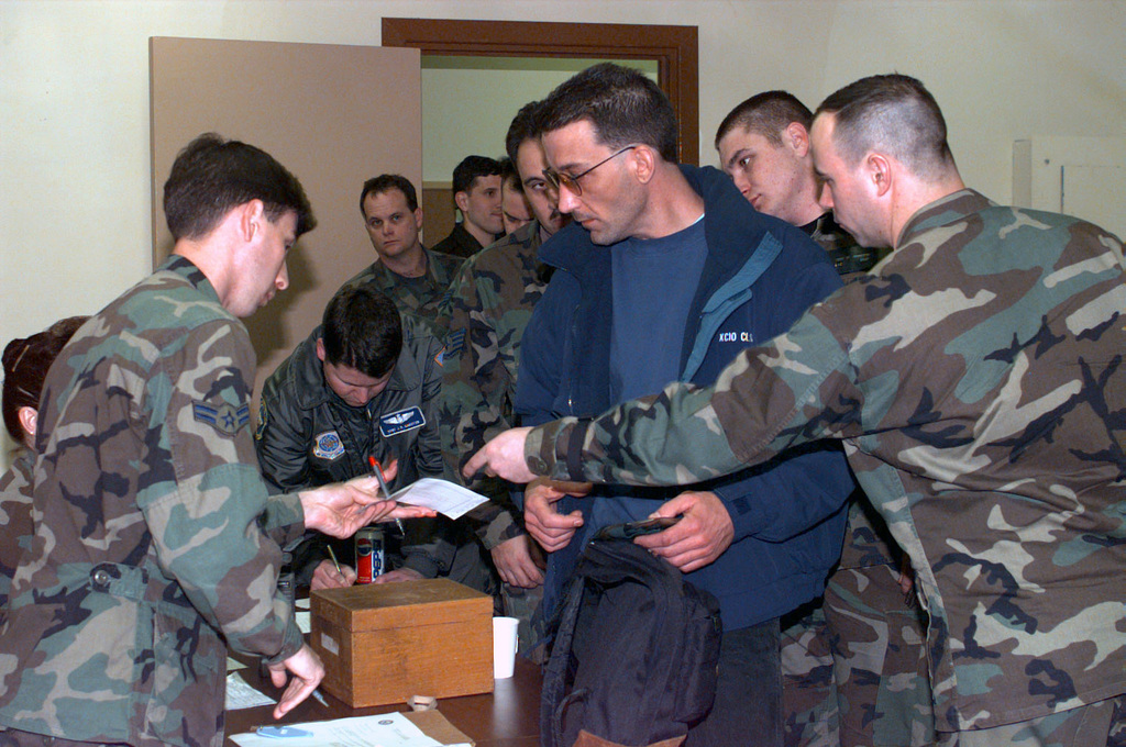 Members assigned to an advanced maintenance team from the 305th Air Mobility Wing, McGuire Air Force Base, New Jersey, receive billeting assignments while in-processing at Moron Air Base (AB), Spain. The team is deployed to Moron AB to support the large influx of aircraft in support of the AIR EXPEDITIONARY FORCE (AEF) 97-1. Under the AEF concept almost all of the Air Force will be divided into 10 force packages, each with a cross-section of Air Force weapon systems drawn from geographically separated units. These AEF packages will be able to respond within 72 hours of notification of any unexpected contingency
