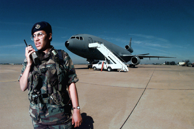 AIRMAN First Class (A1C) Michelle Torres a Security Police Apprentice, assigned to the 52nd Fighter Wing, 852nd Munitions Support Squadron, Buchel Air Base, Germany, stands guard on the flight line at Moron Air Base, Spain. A1C Torres is deployed to Moron Air Base in support of AIR EXPEDITIONARY FORCE (AEF) 97-1. Under the AEF concept almost all of the Air Force will be divided into 10 force packages, each with a cross-section of Air Force weapon systems drawn from geographically separated units. These AEF packages will be able to respond within 72 hours of notification of any unexpected contingency