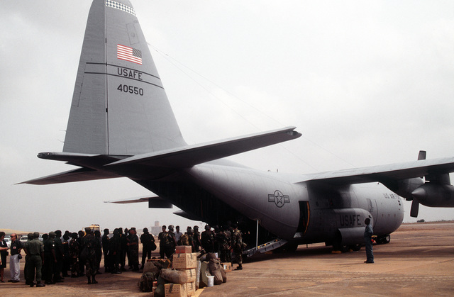 Economic Community Military Observation Group 13 (ECOMOG) Ghana Army troops board a U.S. Air Force, 86th Air Wing, Ramstein AB, Germany C-130E Hercules airlifter at Accra Airport, Ghana. The troops are being airlifted to Robert's International Airport, Liberia for a six month deployment. Operation Assured Lift is a 17- day United States airlift and support mission assisting the West African states deploying more than 1100 troops to Liberia as part of the region's ongoing peacekeeping force