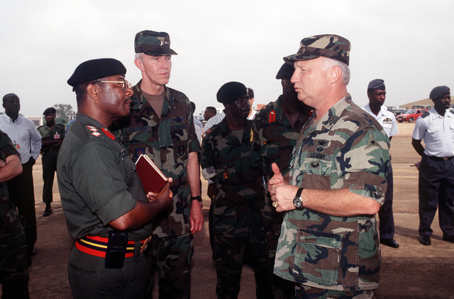 Major General Tad J. Oelstrom (center) listens as U.S. Army COL. Gerald Saltness (right), talks to Ghana Army Colonel George Brock about the Ghana Army troops being airlifted on U.S. military aircraft. The troops are participating in Operation Assured Lift, a 17 day United States airlift and support mission assisting West African states in deploying more than 1100 troops to Liberia as part of the region's ongoing peacekeeping force. MAJ. GEN. Oelstrom is Commander of US Air Force Europe 3rd Air Force, RAF Mildenhall, United Kingdom and Commander of Joint Task Force Operation Assured Lift. COL. Saltness is the U.S. Embassy Defense Attache (DAO) in Abidjan Cote d'Ivore (Ivory Coast). Ghana ...