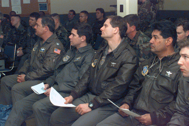 Members assigned to the 305th Air Mobility Wing, McGuire Air Force Base, New Jersey, attend an orientation briefing upon their deployment to Moron Air Base, Spain, in support of AIR EXPEDITIONARY FORCE (AEF) 97-1. Under the AEF concept almost all of the Air Force will be divided into 10 force packages, each with a cross-section of Air Force weapon systems drawn from geographically separated units. These AEF packages will be able to respond within 72 hours of notification of any unexpected contingency