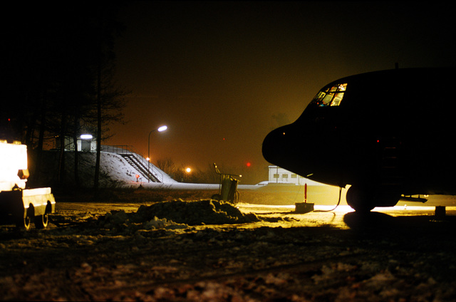 A 40th Airlift Squadron (AS) C-130H sits at night on the frozen, snow covered flight line at this United States Air Force Europe (USAFE) base. The 40th AS is assigned to the 7th Wing, Dyess Air Force Base, Texas and is deployed to Ramstein to support Operations Joint Endeavor and Joint Guard from 4 Dec. 1996 to 23 Jan. 1997