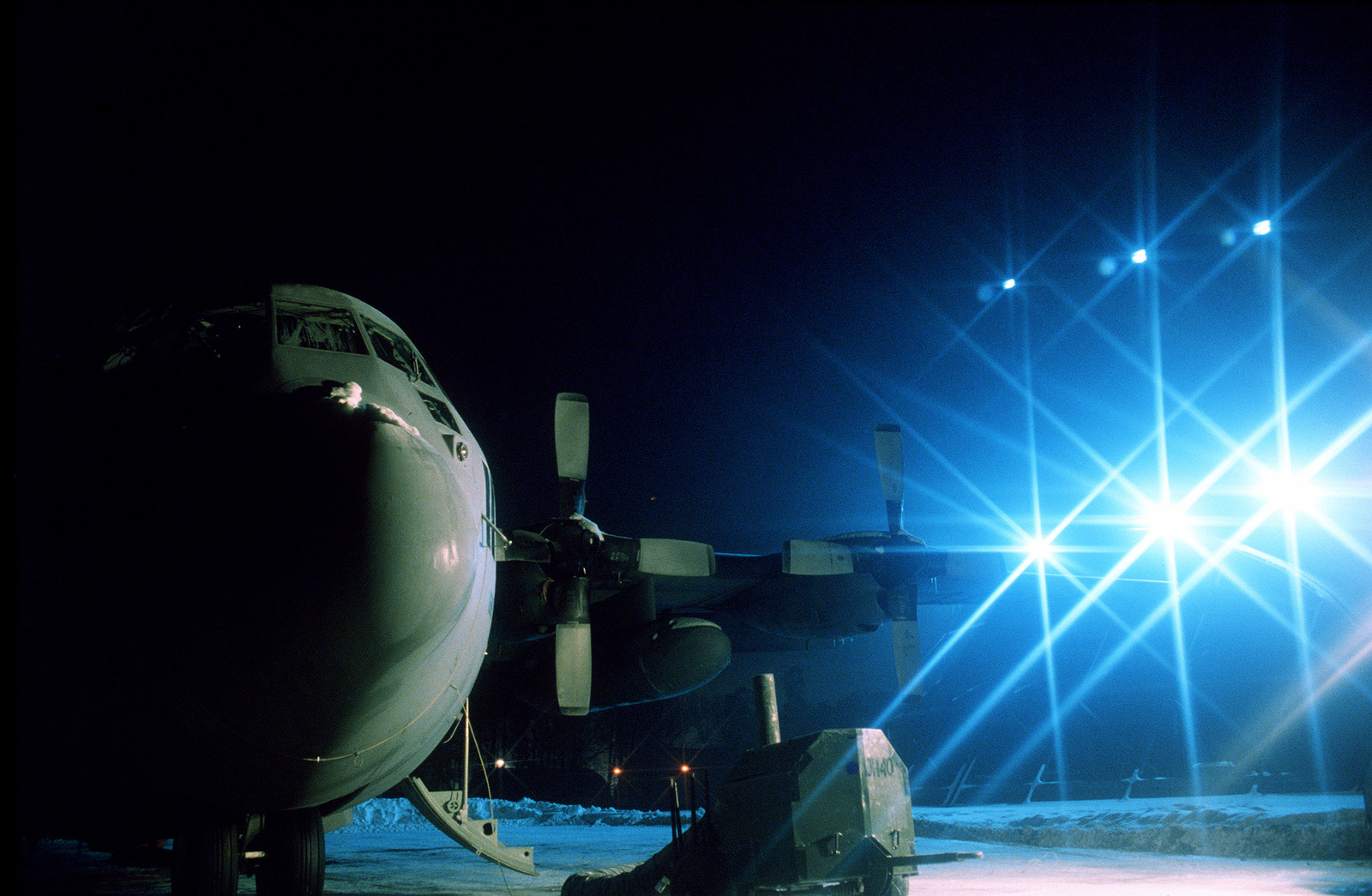 A 40th Airlift Squadron (AS) C-130H sits on the snow covered flight line ramp. The 40th AS is assigned to the 7th Wing, Dyess Air Force Base, Texas and is deployed to Ramstein to support Operations Joint Endeavor and Joint Guard from 4 Dec. 1996 to 23 Jan. 1997