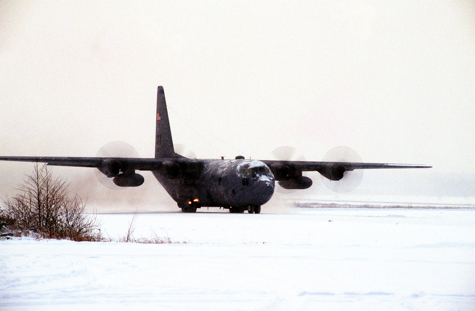 A 40th Airlift Squadron (AS) C-130H taxies on the snow covered flight line at this United States Air Force Europe (USAFE) base. The 40th AS is assigned to the 7th Wing, Dyess Air Force Base, Texas and is deployed to Ramstein to support Operations Joint Endeavor and Joint Guard from 4 Dec. 1996 to 23 Jan. 1997