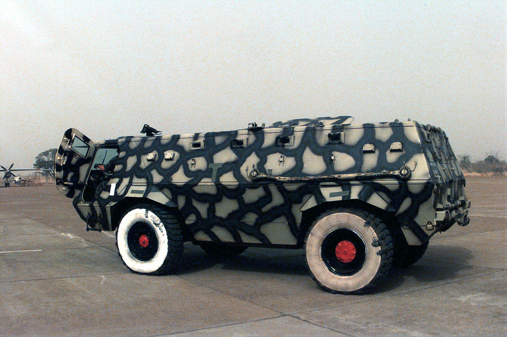 United States Air Force personnel from the 86th Airlift Wing out of Ramstein Air Base, Germany, prepare a Armor Personnel Carrier (APC) belonging to Economic Community ilitary Observation Group (ECOOG) ali Army Troops at Bamako/Senou Airport in ali. The vehicle will be transported with ali Army Troops on a United States Air Force C-130E Hercules aircraft to Roberts International Airport in Liberia for a six month deployment in support of Operation ASSURED LIFT. ASSURED LIFT is a Joint Task Force (JTF) operation to provide airlift and other logistical support to West African states that are deploying more than 600 troops to Liberia as part of the regions ongoing peacekeeping mission....