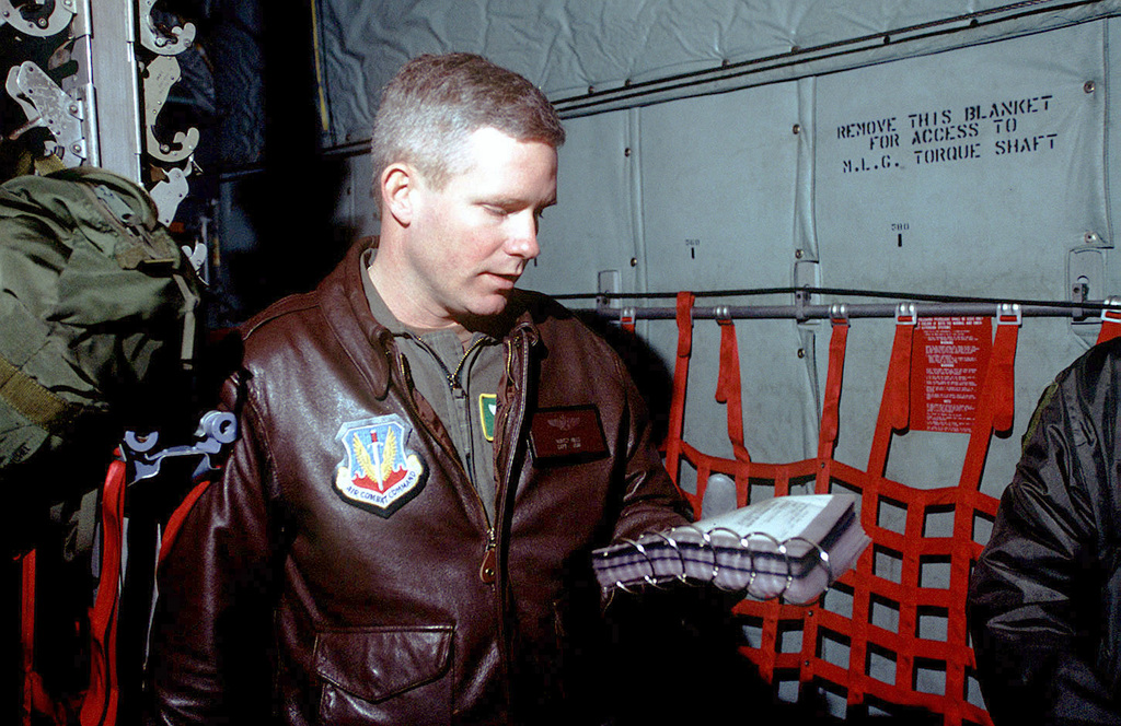 Captain Hunter Mills, assigned to 61st Airlift Squadron (AS), Little Rock Air Force Base, Arkansas, briefs aircrew prior to days mission to Tuzla Air Base, Bosnia. The Green Hornets are deployed to Ramstein Air Base, Germany for a 100-day Temporary Duty (TDY) tour assisting Operation JOINT GUARD (previously Operation JOINT ENDEAVOR). Flying C-130 Hercules every day to Former Yugoslav region (primarily Tuzla) y pick up and deliver cargo and passengers in support of Operation JOINT GUARD. JOINT GUARD enforces Dayton Peace Accords and with multi-national allies continues to monitor militaries of former warring factions and provides a climate of stability in...