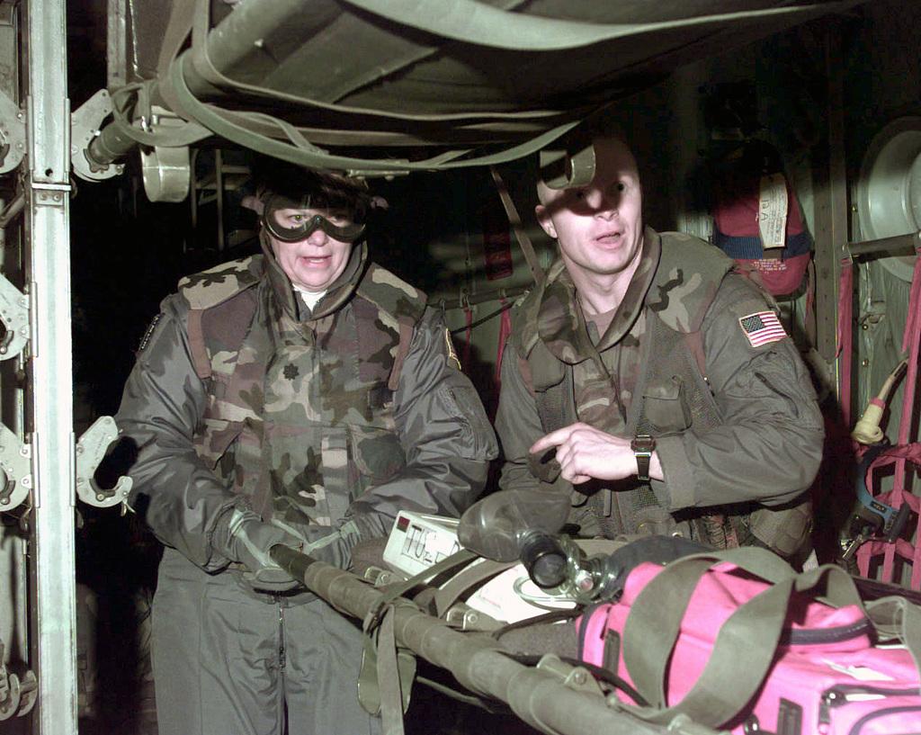 Flight nurse Lieutenant Colonel Karen Wolf and another