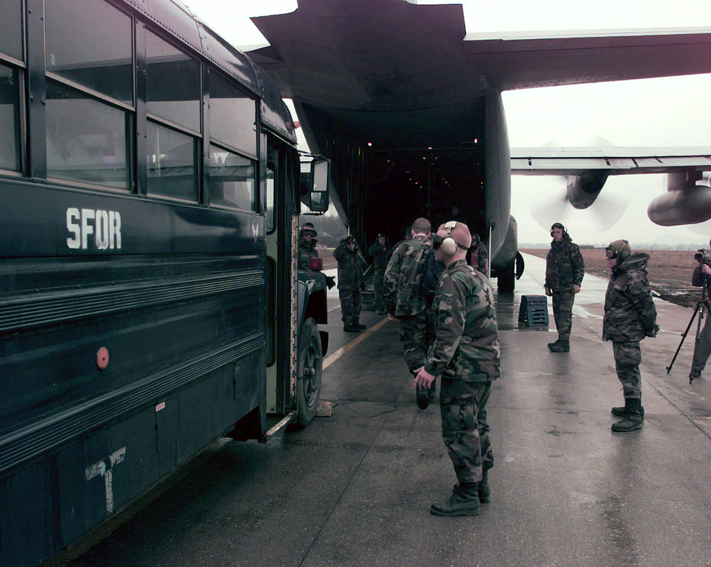 Passengers leaving Tuzla Air Base (AB), Bosnia-Herzegovina, bound for Ramstein AB, Germany, completing a hasty trade of cargo and personnel while the engines are running. The Green Hornets of the 61st Airlift Squadron (AS), Little Rock Air Force Base, Arkansas, fly and maintain their C-130 Hercules Air Transports while deployed to Ramstein AB for a 100 day Temporary Duty (TDY) tour assisting Operation T GUARD (previously Operation T ENDEAVOR). Flying C130's every day to the Former Yugoslav region (primarily Tuzla) they pick up and deliver cargo and passengers in support of Operation T GUARD. Tuzla is the dispersion and collection point for supplies, vehicles and personnel....