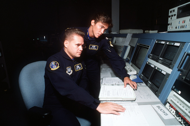 Weather specialists, SSGT Shawn Starrs (left) and CPT Judy Konecky, members of the Department of Defense Manned Space Flight Support office, often decide when it is safe for a space orbiter to launch or land at Cape Kennedy. Exact Date Shot Unknown Published in AIRMAN Magazine March 1997