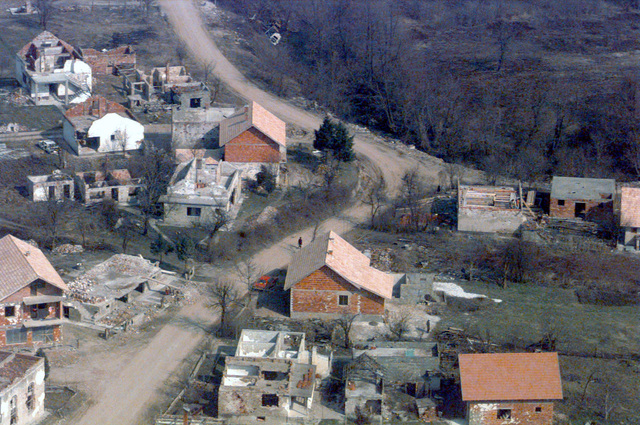 Boce Intersection at grid CQ234643. Aerail Recon taken during Operation JOINT GUARD. On December 20, 1996, the Implementation Force (IFOR) mission came to a conclusion and the 1ST Infantry Division was selected to continue serving in Bosnia as part of the new Stabilization Force (SFOR). This decision brought to close the peace mission of Operation JOINT ENDEAVOR and has been the beginning for the current operation known as Operation JOINT GUARD. JOINT GUARD will continue to monitor the militaries of the former warring factions and provide a climate of stability