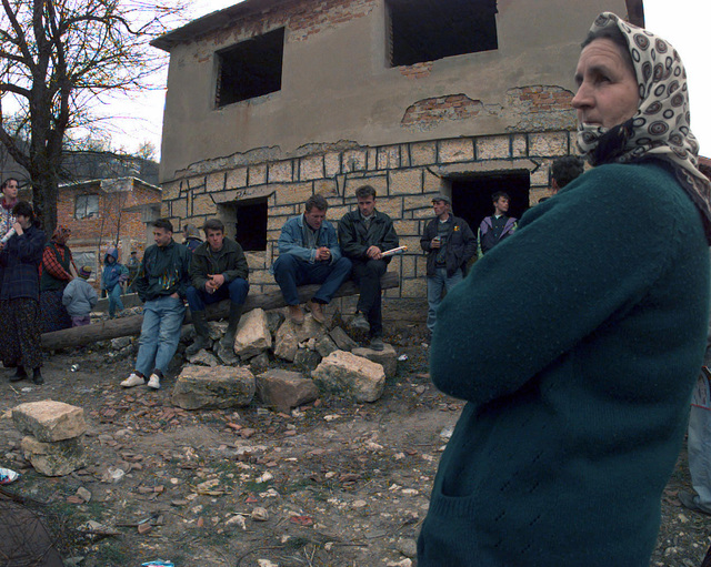 Muslim residents from the town of Jusici gather outside before receiving their new Serbian ID cards during NATO Operation JOINT GUARD. On December 20, 1996, the Implementation Force (IFOR) mission came to a conclusion and the 1ST Infantry Division was selected to continue serving in Bosnia as part of the new Stabilization Force (SFOR). This decision brought to close the peace mission of Operation JOINT ENDEAVOR and has been the beginning for the current operation known as Operation JOINT GUARD. JOINT GUARD will continue to monitor the militaries of the former warring factions and provide a climate of stability