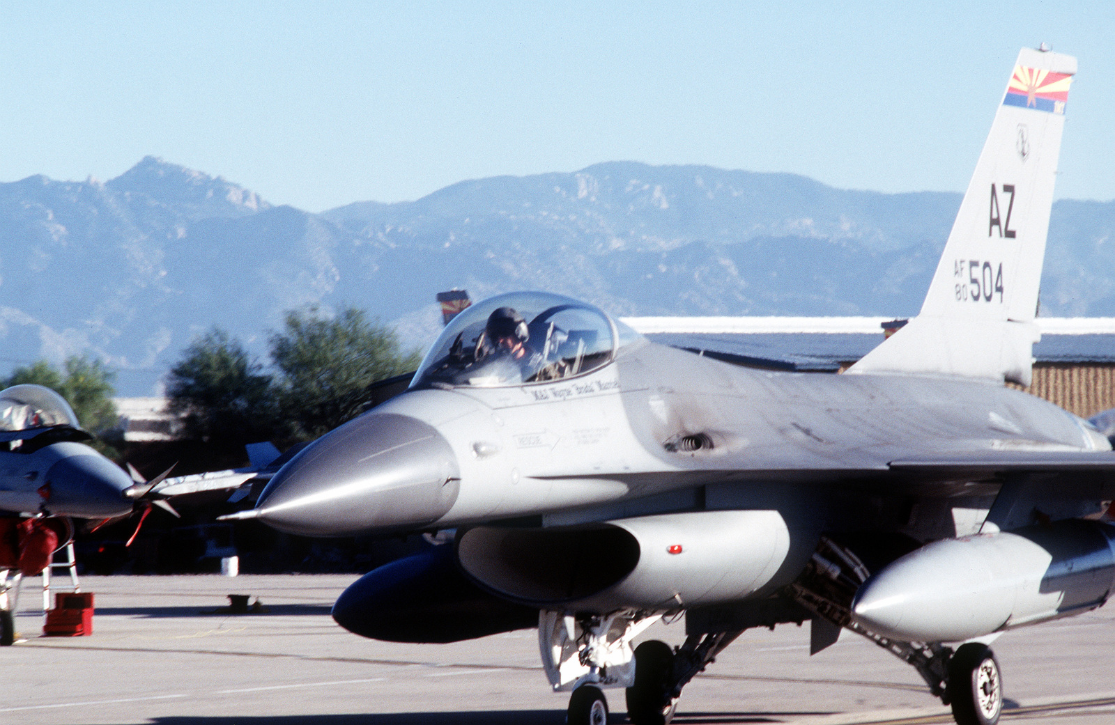 An F-16 from the 162nd Fighter Wing is awaiting taxi clearance at