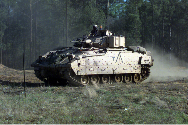 M2 Bradley Infantry fighting vehicle (IFV) bridges an obstacle during an exercise