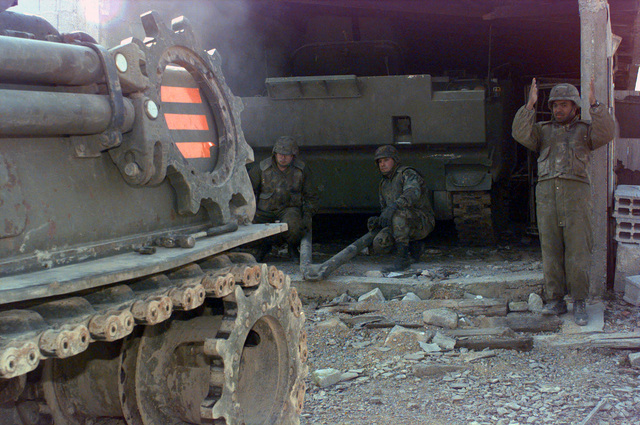 Sergeant Brooks, of the 1/26 Task Force, assigned to Charlie team, ground guides a M88A1 Track Recovery Vehicle, to the Dutch YRP-765 Armored Personnel Carrier, to be toed aay from eapons storage site in the ton of Karakaj, Bosnia, during Operation JOINT GUARD. On December 20, 1996, the Implementation Force (IFOR) mission came to a conclusion and the 1ST Infantry Division as selected to continue serving in Bosnia as part of the ne Stabilization Force (SFOR). This decision brought to close the peace mission of Operation JOINT ENDEAVOR and has been the beginning for the current operation knon as Operation JOINT GUARD. JOINT GUARD ill continue to monitor the militaries of the former...
