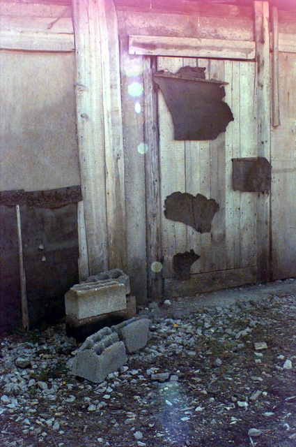 This is the door that the Serbian Army had closed with cement blocks in front of it. They used this door to help conceal the Dutch YRP-765 Armored Personnel Carrier from aerial reconnaissance and patrols done on the ground during Operation JOINT GUARD. On December 20, 1996, the Implementation Force (IFOR) mission came to a conclusion and the 1ST Infantry Division was selected to continue serving in Bosnia as part of the new Stabilization Force (SFOR). This decision brought to close the peace mission of Operation JOINT ENDEAVOR and has been the beginning for the current operation known as Operation JOINT GUARD. JOINT GUARD will continue to monitor the militaries of the former warring...