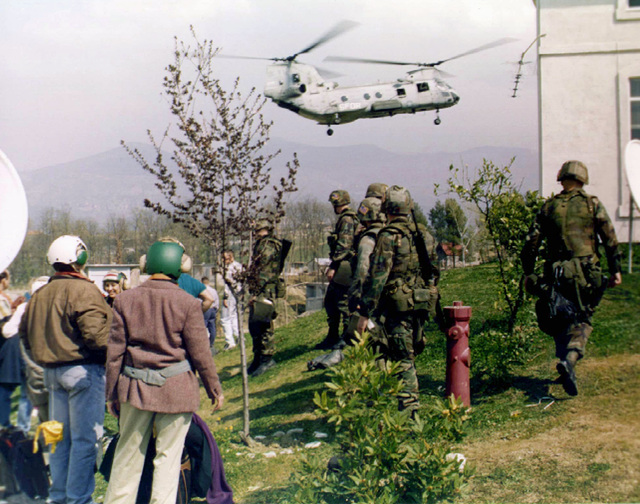 """A CH-46E """"Sea Knight"""" helicopter lifts out of the evacuation site at the US Embassy in Tirana, Albania, on its way to the USS Nassau during Operation SILVER WAKE. The 26th MEU (SOC) (Marine Expeditionary Unit (Special Operations Capable)) was called upon to perform a NEO (Non-combatant Evacuation Operation) of US citizens that desired to leave Albania, due to the current civil strife"""