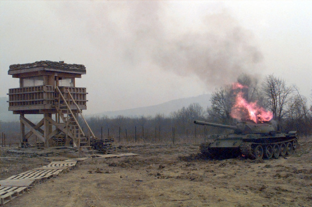 This is a long shot of the T55 Russian Tank that was being destroyed in the field artillery area of operation on Camp Dobol, Bosnia, during Operation JOINT GUARD. On December 20, 1996, the Implementation Force (IFOR) mission came to a conclusion and the 1ST Infantry Division was selected to continue serving in Bosnia as part of the new Stabilization Force (SFOR). This decision brought to close the peace mission of Operation JOINT ENDEAVOR and has been the beginning for the current operation known as Operation JOINT GUARD. JOINT GUARD will continue to monitor the militaries of the former warring factions and provide a climate of stability