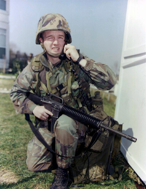 Armed with an M16A2, Corporal James Kendrick, Command Element, 26th Marine Expeditionary Unit (Special Operations Capable) (MEU(SOC)), provides the communications link from ship to shore for ground commanders during Operation SILVER WAKE. The 26th MEU (SOC) was called upon to perform a NEO (Non-combatant Evacuation Operation) of US citizens that desired to leave Albania, due to the current civil strife
